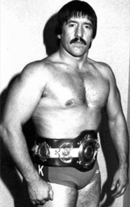 Black and white image of Alan Kilby in wrestling outfit.