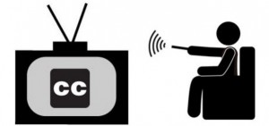 Cartoon stick figure sitting on couch using remote to turn on closed captions on a TV.