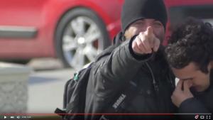 Video still of two men