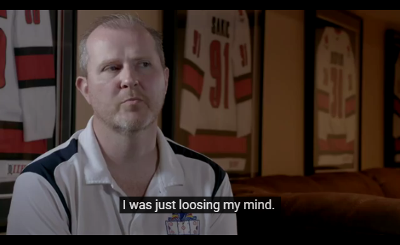 "Screenshot of video with captions. Video shows man in locker room. Captions say ""I was just loosing my mind."""
